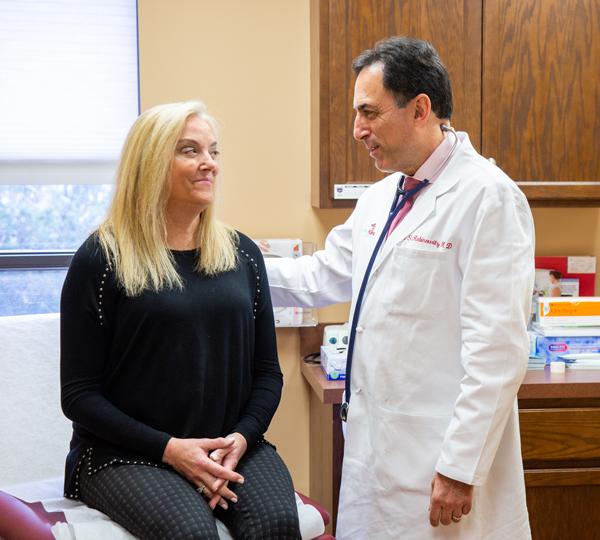Dr. Marc with a patient